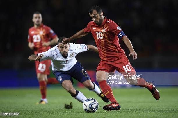 Macedonia's forward Goran Pandev outruns Italy's defender Andrea Barzagli during the FIFA World Cup 2018 qualification football match between Italy...