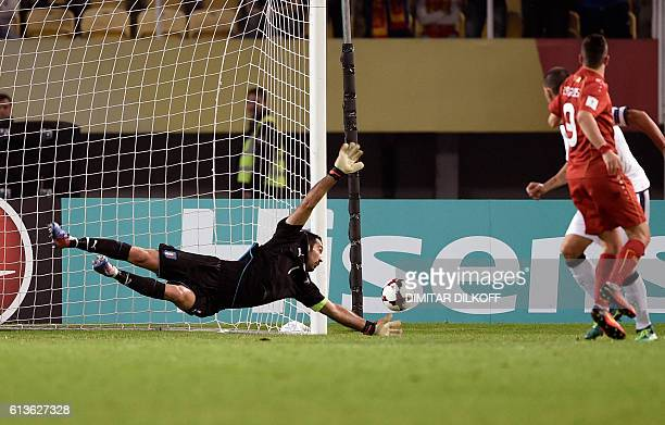 Macedonia's forward Ilija Nestorovski scores a goal during the FIFA World Cup 2018 qualifying football match Macedonia versus Italy on October 9 2016...
