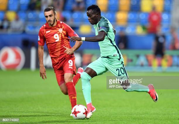 Macedonia's forward Marjan Radeski and Portugal's midfielder Bruma vie for the ball during the UEFA U21 European Championship Group B football match...