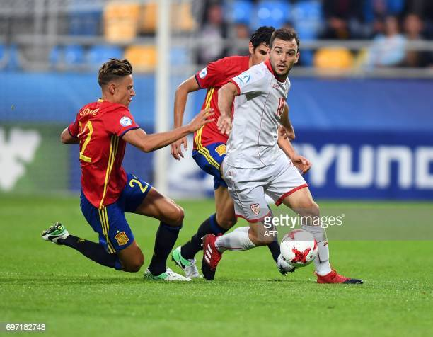 Macedonia's forward Viktor Angelov and Spain's midfielder Marcos Llorente vie for the ball during the group stage Group B match Spain vs FYR...