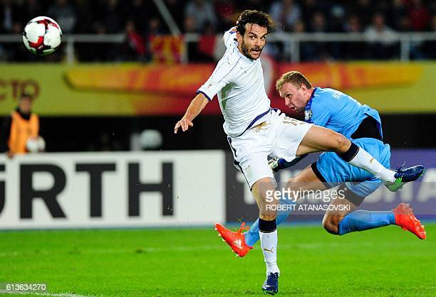Macedonia's goalkeeper Martin Bogatinov vies with Italy's midfielder Marco Parolo during the FIFA World Cup 2018 qualifying football match between...
