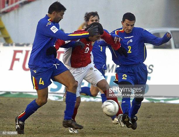 Macedonia's Goran Pandev fights for the ball with Andorra's Oscar Sonesee and Luena Garcia during their World Cup 2006 Qualifying football match at...