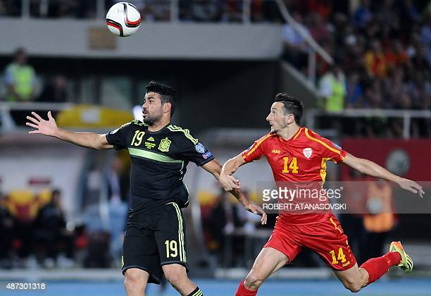 Macedonia's Kire Ristevski vies with Spain's Diego Costa during the Euro 2016 qualifying football match between Macedonia and Spain at Filip II...
