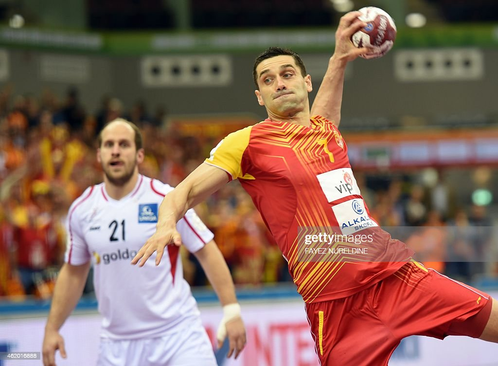 Macedonia's <a gi-track='captionPersonalityLinkClicked' href=/galleries/search?phrase=Kiril+Lazarov&family=editorial&specificpeople=3239733 ng-click='$event.stopPropagation()'>Kiril Lazarov</a> (R) attempts a shot on goal as Austria's Roland Schlinger looks on during the 24th Men's Handball World Championships preliminary round Group B match between Macedonia and Austria at the Ali Bin Hamad Al Attiya Arena in Doha on January 23, 2015. AFP PHOTO / FAYEZ NURELDINE