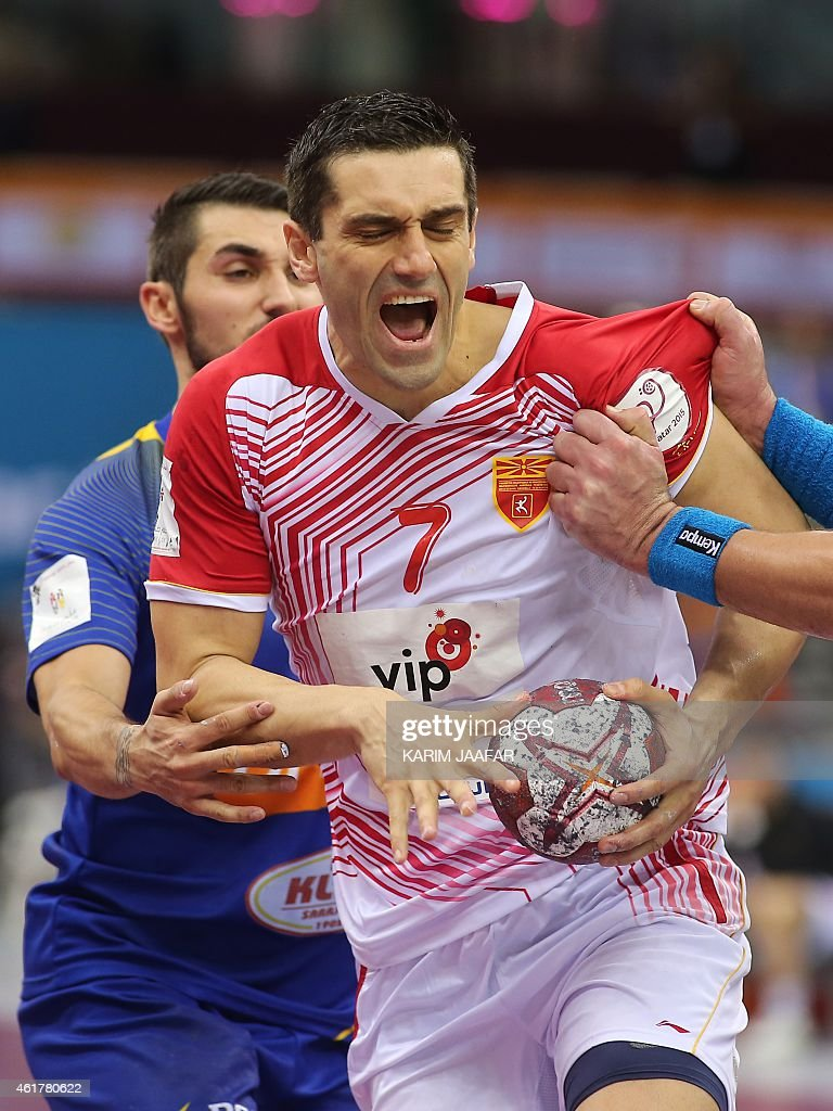 Macedonia's <a gi-track='captionPersonalityLinkClicked' href=/galleries/search?phrase=Kiril+Lazarov&family=editorial&specificpeople=3239733 ng-click='$event.stopPropagation()'>Kiril Lazarov</a> (C) tries to escape from Bosnia and Herzegovina's Alen Ovcina (L) during the 24th Men's Handball World Championships preliminary round Group B match between Bosnia and Herzegovina and Macedonia at the Ali Bin Hamad Al Attiya Arena in Doha on January 19, 2015. AFP PHOTO / AL-WATAN DOHA / KARIM JAAFAR OUT ==