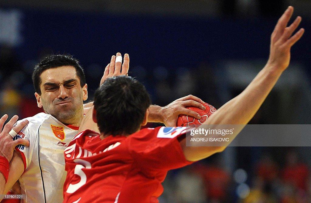 Macedonia's Kiril Lazarov (L) vies with Poland's Krzysztof Lijewski (R) during the men's EHF Euro 2012 Handball Championship match Poland vs Macedonia on January 23, 2012, at the Belgrade Arena. AFP PHOTO / ANDREJ ISAKOVIC