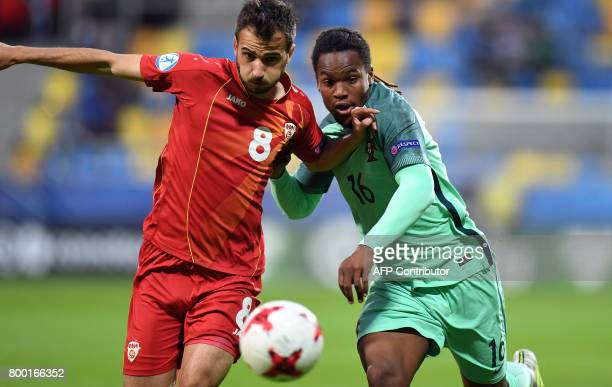 Macedonia's midfielder Boban Nikolov and Portugal's midfielder Renato Sanches vie for the ball during the UEFA U21 European Championship Group B...