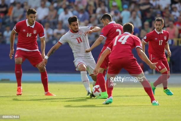 Macedonia's midfielder Daniel Avramovski and Serbia's defender Milan Gajic vie for the ball during the UEFA U21 European Championship Group B...