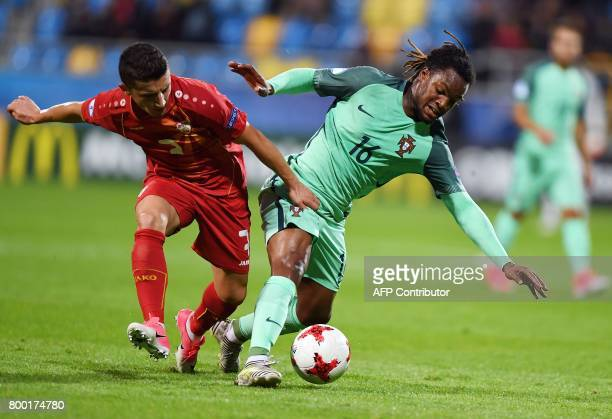 Macedonia's midfielder Enis Bardi Portugal's midfielder Renato Sanches vie for the ball during the UEFA U21 European Championship Group B football...