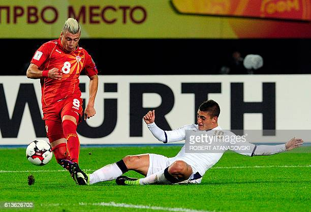 Macedonia's midfielder Ezgjan Alioski vies with Italy's midfielder Italian midfielder Marco Verratti during the FIFA World Cup 2018 qualifying...