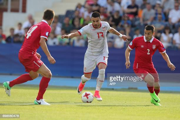 Macedonia's midfielder Kire Markoski and Serbia's defender Milan Gajic vie for the ball during the UEFA U21 European Championship Group B football...
