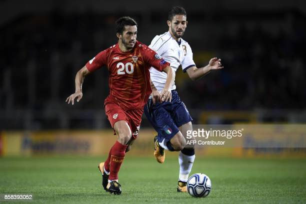 Macedonia's midfielder Stefan Spirovski fights for the ball with Italy's midfielder Roberto Gagliardini during the FIFA World Cup 2018 qualification...