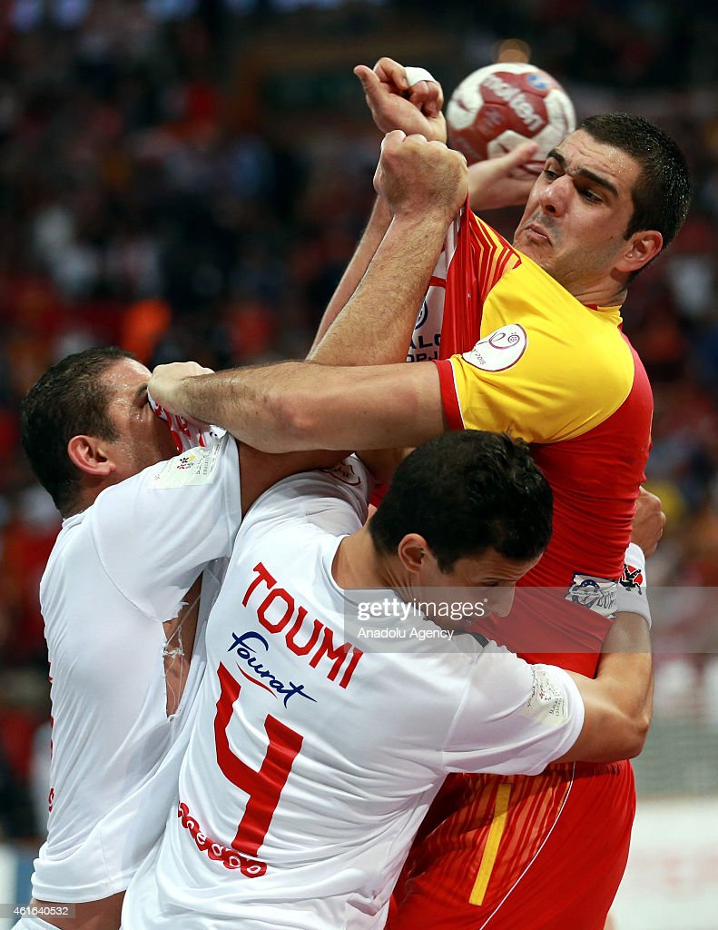 Macedonia's Nikola Markoski (R) challenges Tunisia's Aymen Toumi (C) and <a gi-track='captionPersonalityLinkClicked' href=/galleries/search?phrase=Issam+Tej&family=editorial&specificpeople=2085539 ng-click='$event.stopPropagation()'>Issam Tej</a> (L) for the ball during the 24th Men's Handball World Championships preliminary round Group B match Macedonia vs Tunisia at the Lusail Sports Arena in Qatar on January 16, 2015.