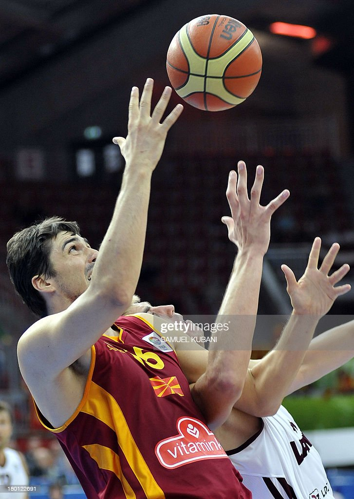 Macedonia's Predrag Samardziski (L) challenges Latvia's Martins Meiers during the 2013 EuroBasket Championship group B match between F.Y.R. Macedonia and Latvia in Jesenice on September 9, 2013.