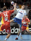 Macedonia's Stojanche Stoilov tries to score in front of Serbia's Mladen Bojinovic and Alem Toskic during their World Handball Championship match in...