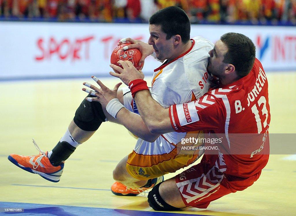 Macedonia's Stojanche Stoilov (L) vies with Poland's Bartosz Jurecki (R) during the men's EHF Euro 2012 Handball Championship match Poland vs Macedonia on January 23, 2012 at the Belgrade Arena.