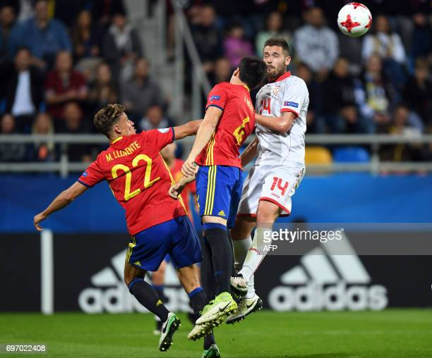 Macedonia's stricker Marjan Radeski and Spain's midfielder Marcos Llorente vie for the ball during the UEFA U21 European Championship Group B...