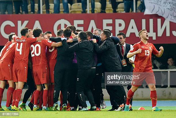 Macedonia's team celebrates after scoring a goal during the FIFA World Cup 2018 qualifying football match Macedonia versus Italy on October 9 2016 at...