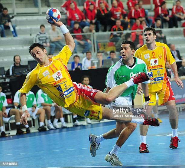 Macedonia's Vladimir Temelkov shoots against Algeria next to Bouakaz Yacine from Algeria and Mitko Stoilov from Macedonia during the Men's World...
