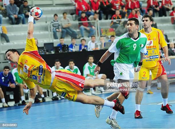 Macedonia's Vladimir Temelkov shots against Algeria next to Bouakaz Yacinn from Algeria and Mitko Stoilov from Macedonia during the Men's World...