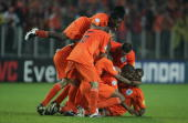 Maceo Rigters of Holland is mobbed by his team mates after he scores their third goal during the UEFA U21 Championship Final match between...