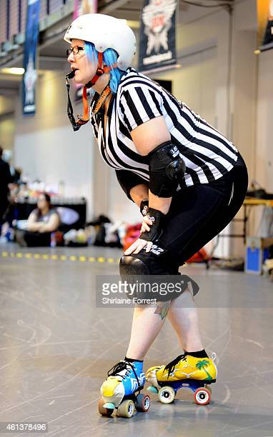 Macfarlane referees Manchester Roller Derby's Checkerbroads vs Portsmouth Roller Wenches bout in the Tattoo Freeze Roller Derby Tournament 2015 at...