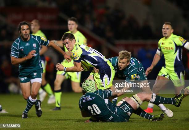 MacGinty of Sale Sharks is tackled by Scott Steele of London Irish during the Aviva Premiership match between Sale Sharks and London Irish at AJ Bell...