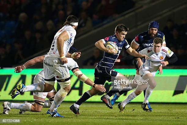 MacGinty of Sale Sharks makes a break during the Aviva Premiership match between Sale Sharks and Exeter Chiefs at AJ Bell Stadium on December 2 2016...