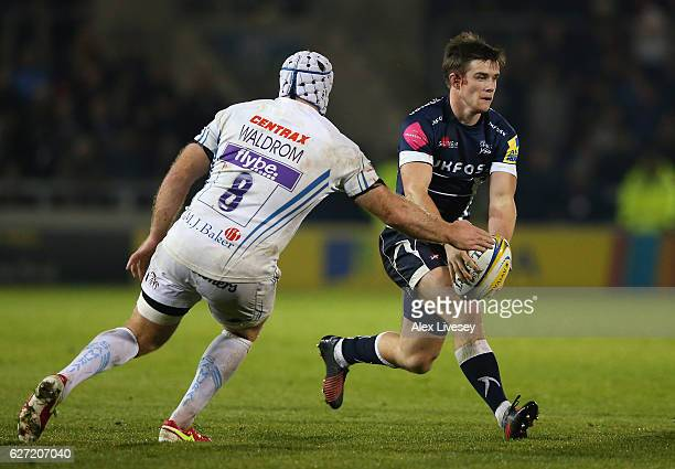 MacGinty of Sale Sharks runs at Thomas Waldrom of Exeter Chiefs during the Aviva Premiership match between Sale Sharks and Exeter Chiefs at AJ Bell...