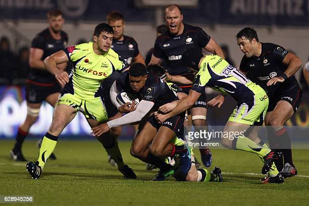 MacGinty of Sale Sharks tackles Nathan Earle of Saracens during the European Rugby Champions Cup match between Saracens and Sale Sharks at Allianz...