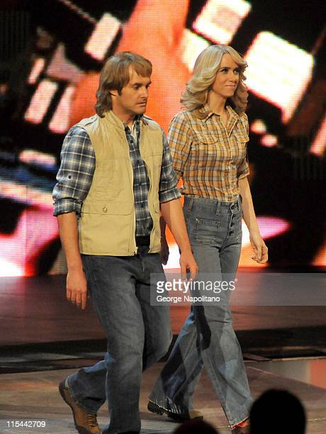 MacGruber cast members Will Forte and Kristen Wiig walk to the ring at the WWE Monday Night Raw at the Izod Center on April 19 2010 in East...