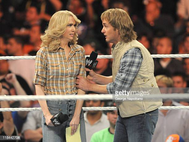 'MacGruber' Will Forte and Kristen Wiig stand in the ring at the WWE Monday Night Raw at the Izod Center on April 19 2010 in East Rutherford New...
