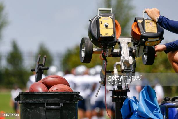 A machine and bucket of footballs are used to simulate punts during Dallas Cowboys minicamp on June 14 2017 at The Star in Frisco TX