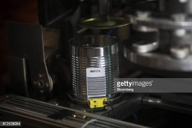 A machine automatically seals a barcoded tin can used to securely transport diamonds sourced from the seabed to onshore vaults aboard the Mafuta...