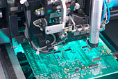 Machine building a motherboard
