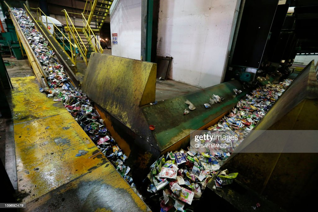 A machine carries garbage for recycling at a waste treatment plant in Burgos on January 18, 2013.