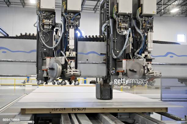 A machine cuts holes into drywall in the wall sheathing area of the Blueprint Robotics facility in Baltimore Maryland US on Tuesday April 10 2017 The...