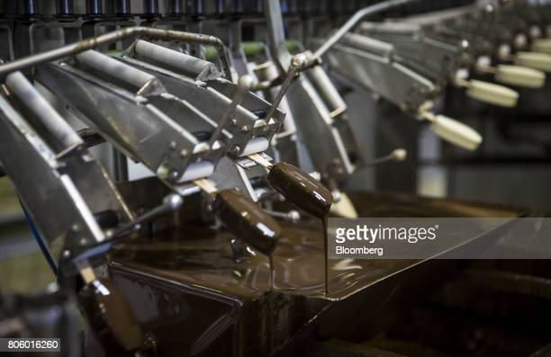 A machine dips King ice creams into chocolate on the production line at the Ledo dd ice cream plant operated by Agrokor dd in Zagreb Croatia on...