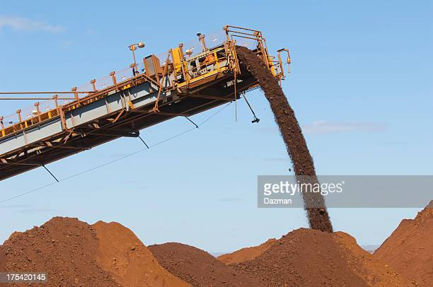 Machine dumping ore in stockpile