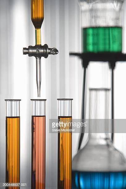 Machine filling test tubes in labratory, close-up