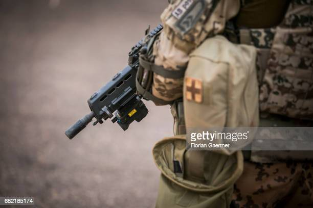 Machine gun in a hand of an soldier on April 07 2017 in Gao Mali