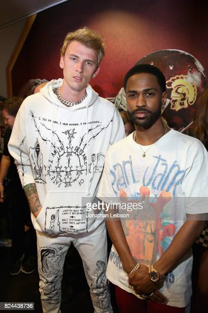 Machine Gun Kelly and Big Sean backstage at Pandora Sounds Like You Summer at Los Angeles Memorial Coliseum on July 29 2017 in Los Angeles California