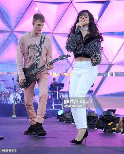 Machine Gun Kelly and Camila Cabello perform at 1027 KIIS FM's 2017 Wango Tango at StubHub Center on May 13 2017 in Carson California