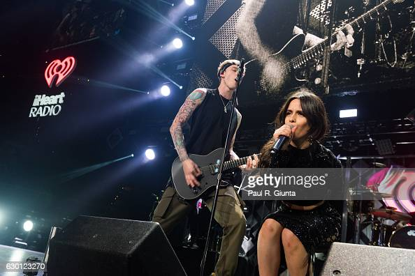 Machine Gun Kelly and Camila Cabello perform on stage during Power 961's Jingle Ball 2016 at Phillips Arena on December 16 2016 in Atlanta Georgia