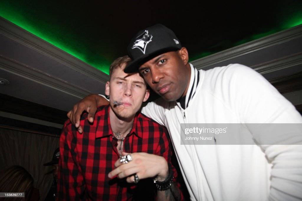 Machine Gun Kelly and <a gi-track='captionPersonalityLinkClicked' href=/galleries/search?phrase=DJ+Whoo+Kid&family=editorial&specificpeople=4360604 ng-click='$event.stopPropagation()'>DJ Whoo Kid</a> attend Machine Gun Kelly's Album Release Party at RDV on October 8, 2012 in New York City.