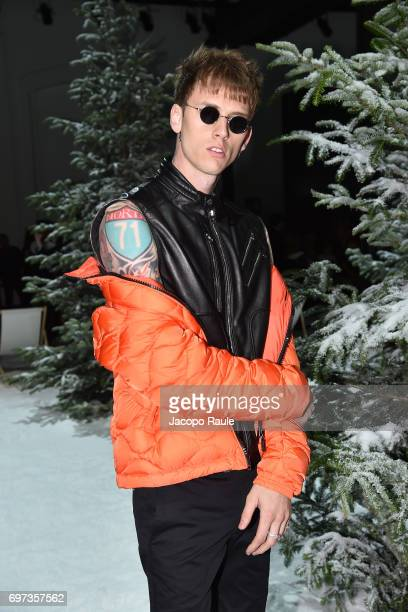 Machine Gun Kelly attends the Moncler Gamme Bleu show during Milan Men's Fashion Week Spring/Summer 2018 on June 18 2017 in Milan Italy