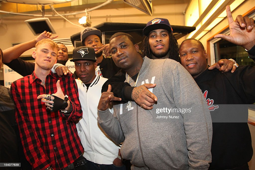 Machine Gun Kelly (L), <a gi-track='captionPersonalityLinkClicked' href=/galleries/search?phrase=DJ+Whoo+Kid&family=editorial&specificpeople=4360604 ng-click='$event.stopPropagation()'>DJ Whoo Kid</a> (secondL), <a gi-track='captionPersonalityLinkClicked' href=/galleries/search?phrase=Gucci+Mane&family=editorial&specificpeople=4468934 ng-click='$event.stopPropagation()'>Gucci Mane</a> (C), Waka Flocka Fame (secondR) and guests invade 'The Whoolywood Shuffle' at SiriusXM Studios on October 8, 2012 in New York City.