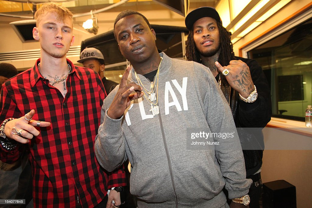 Machine Gun Kelly, <a gi-track='captionPersonalityLinkClicked' href=/galleries/search?phrase=Gucci+Mane&family=editorial&specificpeople=4468934 ng-click='$event.stopPropagation()'>Gucci Mane</a> and Waka Flocka Fame invade 'The Whoolywood Shuffle' at SiriusXM Studios on October 8, 2012 in New York City.