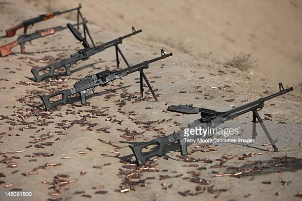 PK machine guns and spent cartridges at the firing range.