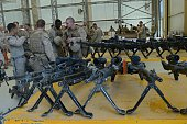 M240 machine guns are pictured on tables as US Marines arrive in Kandahar on October 27 as British and US forces withdraw from the Camp...